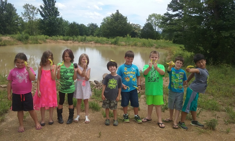 Nine of the Elementary Summer School students pose at the Outdoor Learning Center.